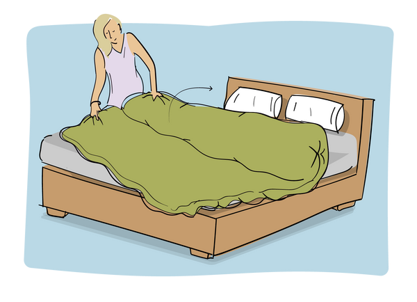 Unroll the covered duvet, by pinching at the matched closure and bottom edge and gently pulling the roll apart and shaking and straightening as you go