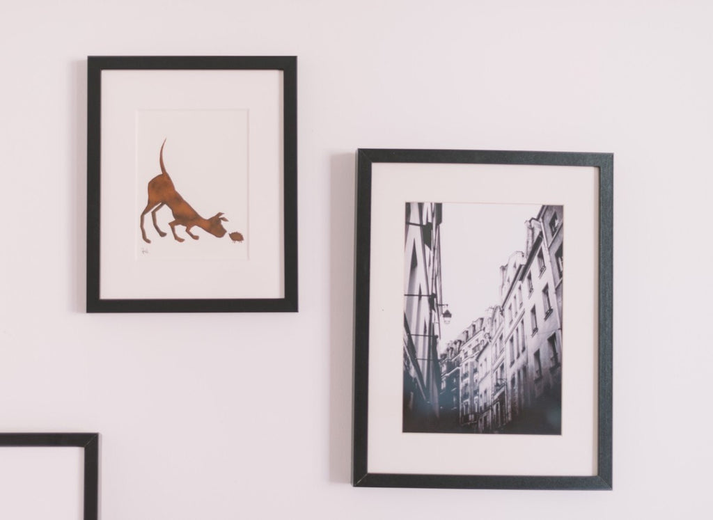 Framed artwork on white wall