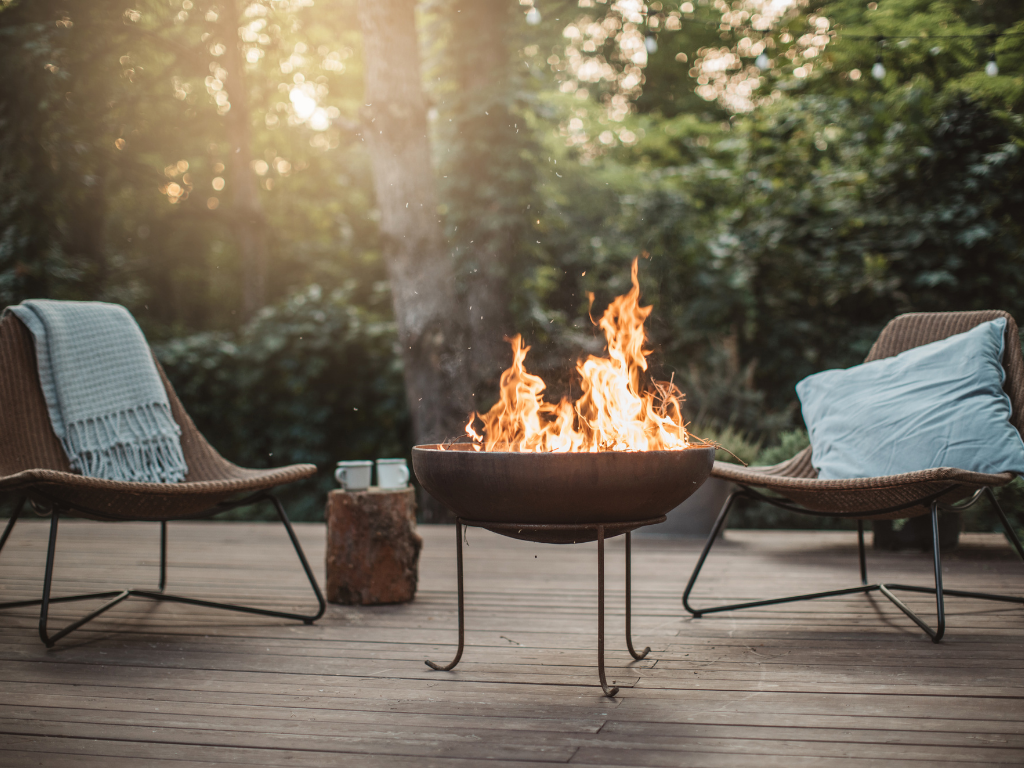 Cozy outdoor space with firepit and two comfy chairs