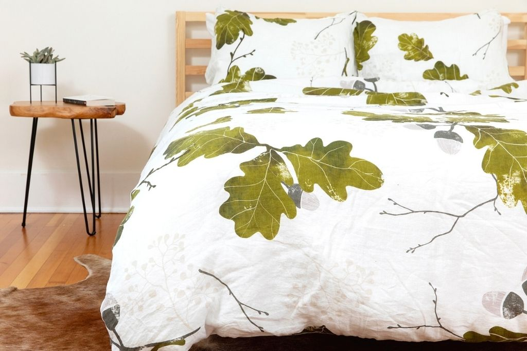 Organic European linen duvet cover in modern Scandinavian design with oak leaves pattern