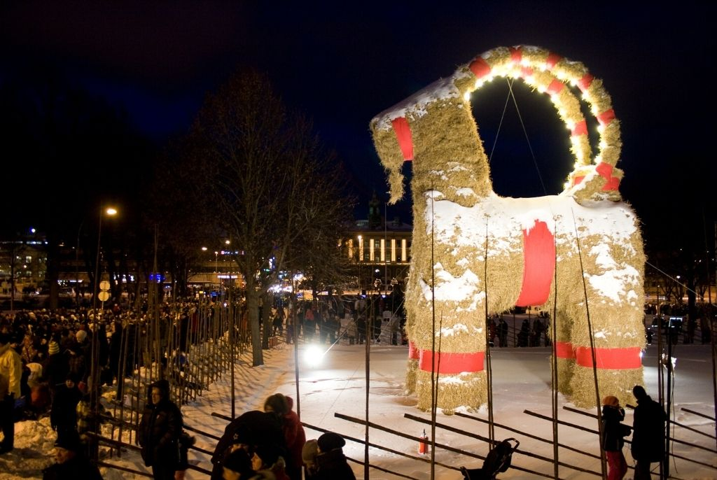 The Gavle Christmas Goat standing near the city Library and river in Gavle, Sweden on its inauguration night in 2010