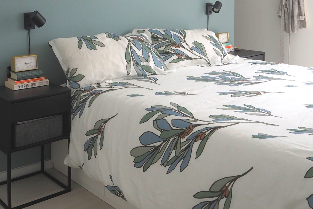 Neatly made bed with The Modern Dane duvet in Scandinavian style bedroom