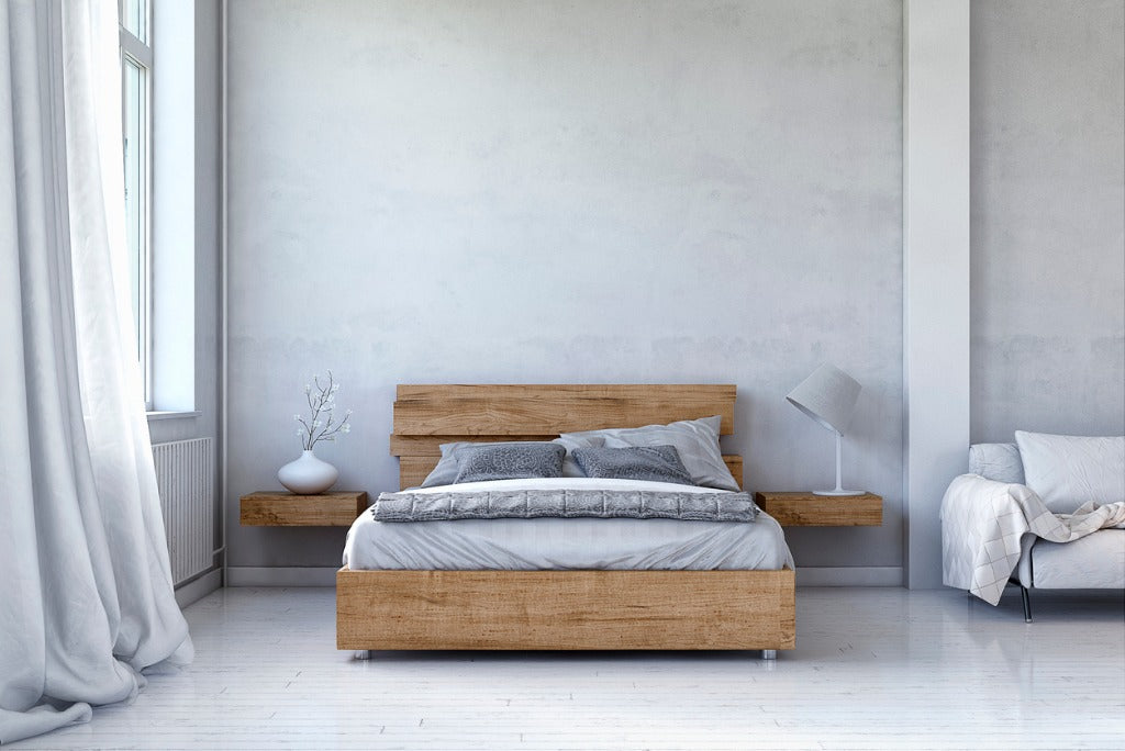 Scandinavian style bedroom with white hardwood floor and concrete wall
