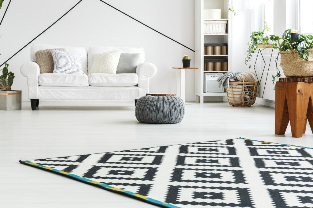 Scandinavian style living room with geometrical pattern rug