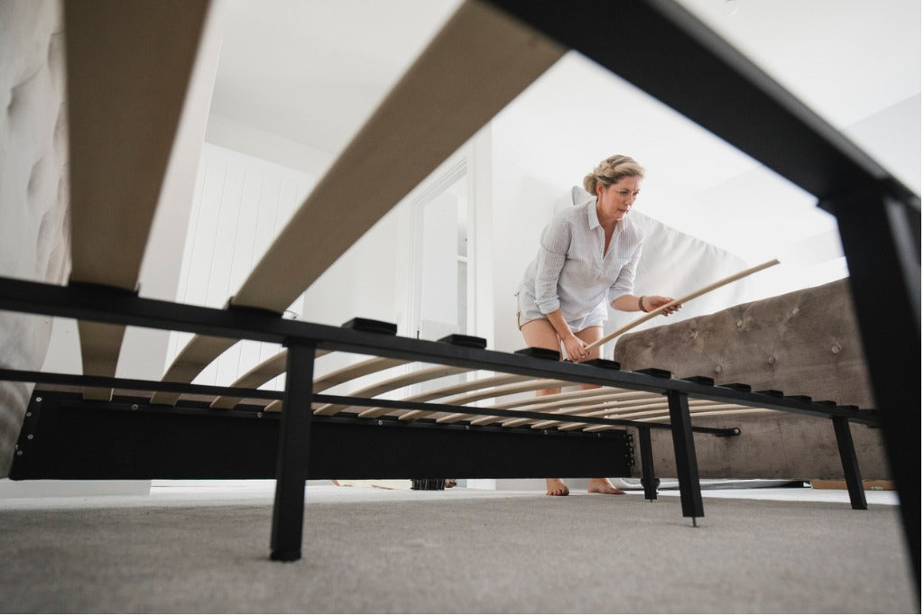 Woman Building Bed in New Home