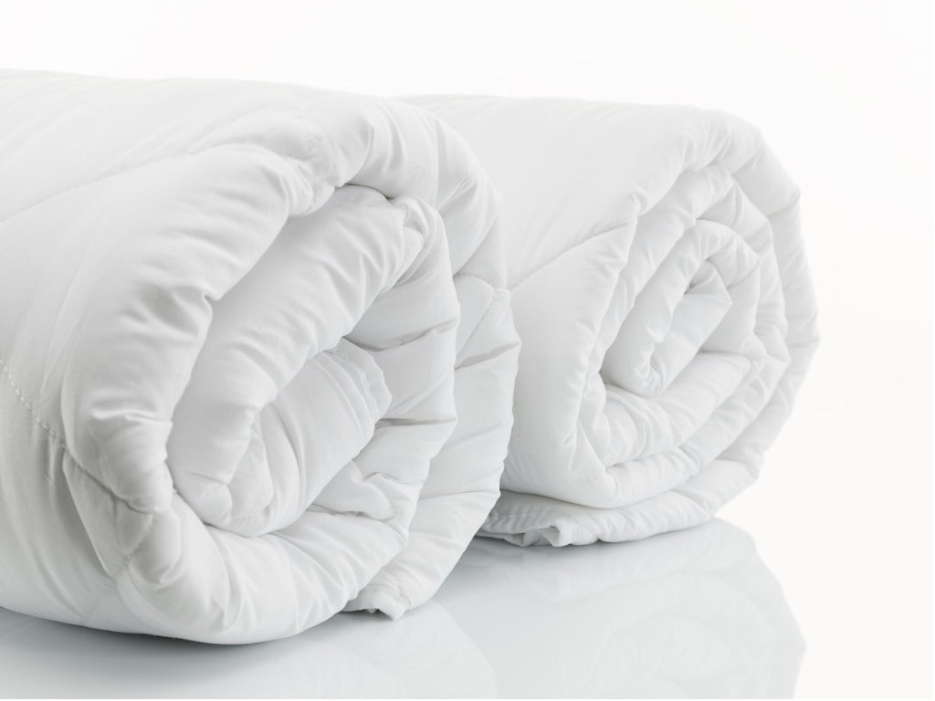 Two white duvet inserts on a white background