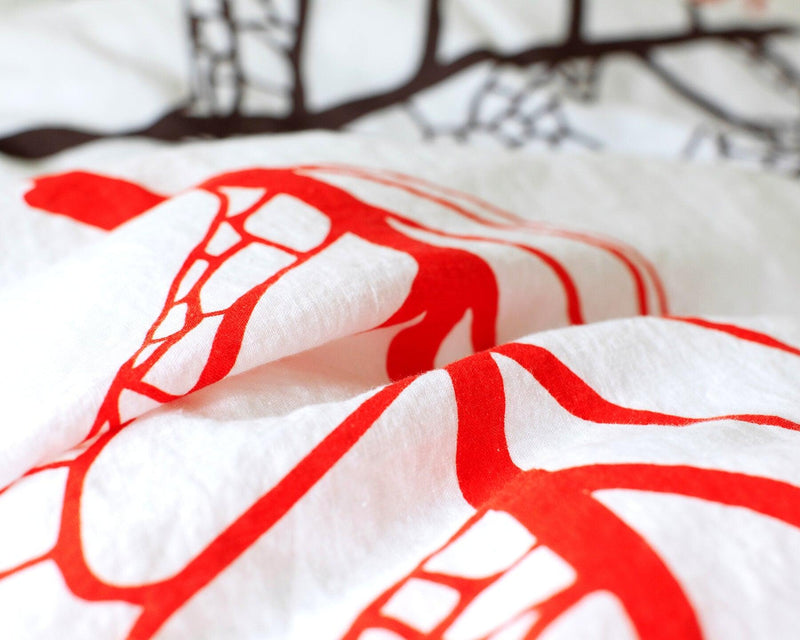 Closeup of European organic linen duvet cover with two matching pillow cases fall leaves design