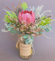 Native flower posy by Native Bunch Sydney northern beaches florist pink Protea, green Leucadendrons, Thryptomene