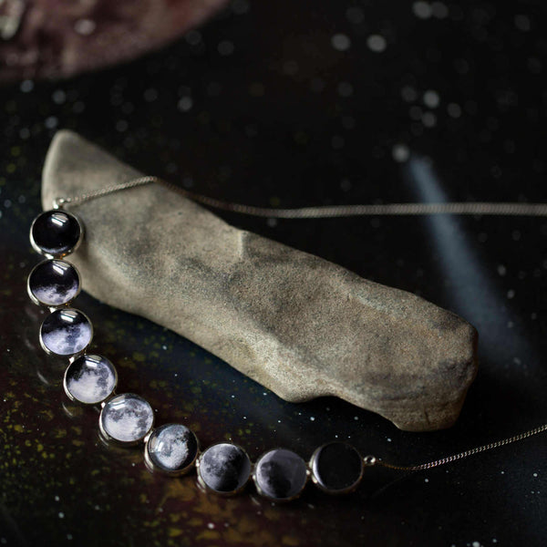 Curved Moon Phase Necklace in Silver - My Modern Met Store