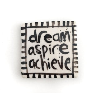 White 'dream, aspire, achieve' tile