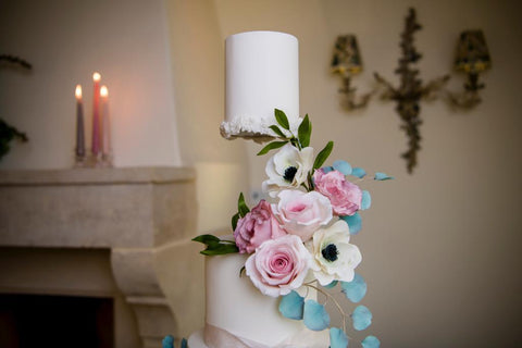 floral white wedding cake with floating cake tier