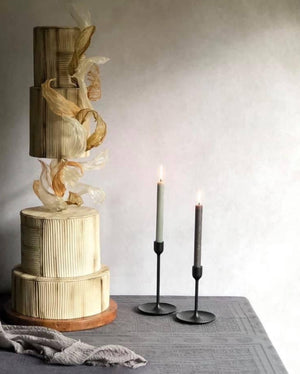 Gravity defying cake separator with central bar gold wedding cake with candles