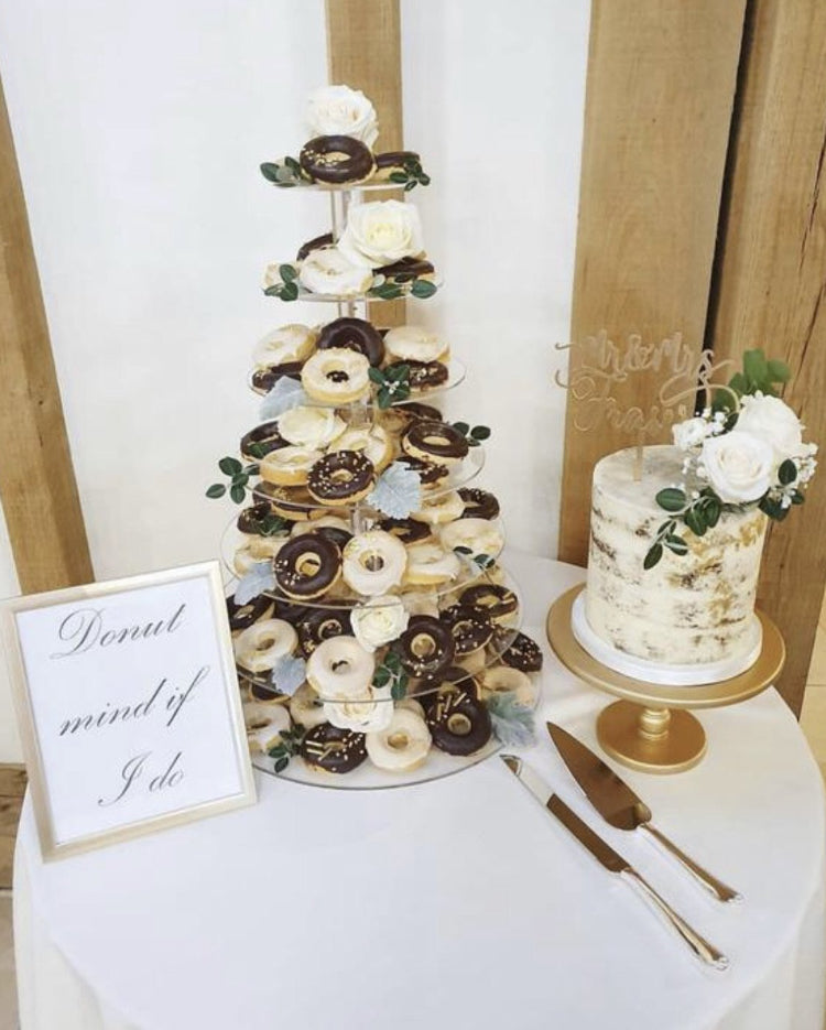 A doughnut display using Prop Options Adjustable acrylic cupcake stand