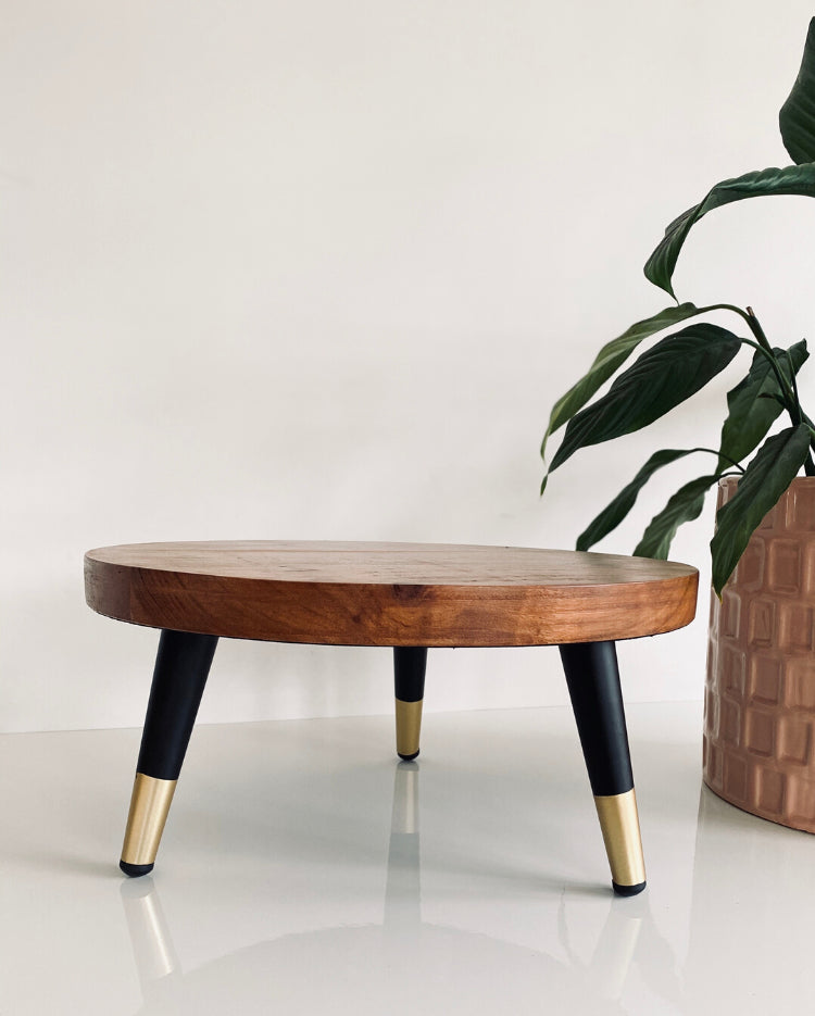 Prop Options Solid wood stand with matte black and gold tapered legs