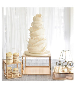 Prop Options Large metallic gold plinth cake stand showcases desserts and sweet treats