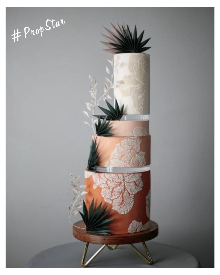 Prop Options #PropStar - Shop the look - gold hairpin acacia wood stand supporting stunning 4 tier cake with exquisite decoration and using Prop Options' ultra-clear acrylic disc spacers