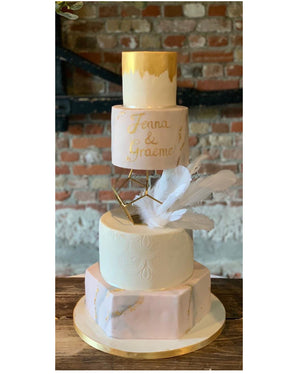 Prop Options Gold Geometric pentagon spacer showcasing beautiful gold decorated tiered cake