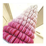 Prop Options stunning 10 tier adjustable macaron tower stand displaying shades of pink macaron tower