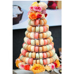 Prop Options stunning 10 tier adjustable macaron tower stand displaying pastel colour macarons and flower decorations