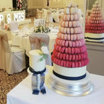 Prop Options stunning 10 tier adjustable macaron tower stand displaying shades of pink macarons and wedding cake