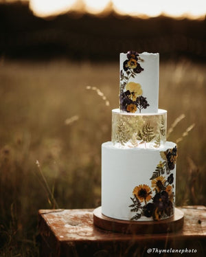 Stunning tiered cake using floral design and Prop Options clear tier expertly decorated with gold leaf design - floating cake  Edit alt text