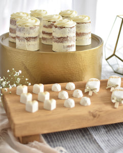 Rustic olive rectangle stand with white chocolate sweets and lollipops