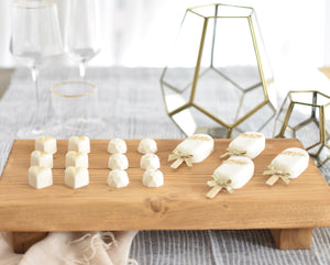 Rustic olive rectangle stand with white chocolate sweets and lollipops display