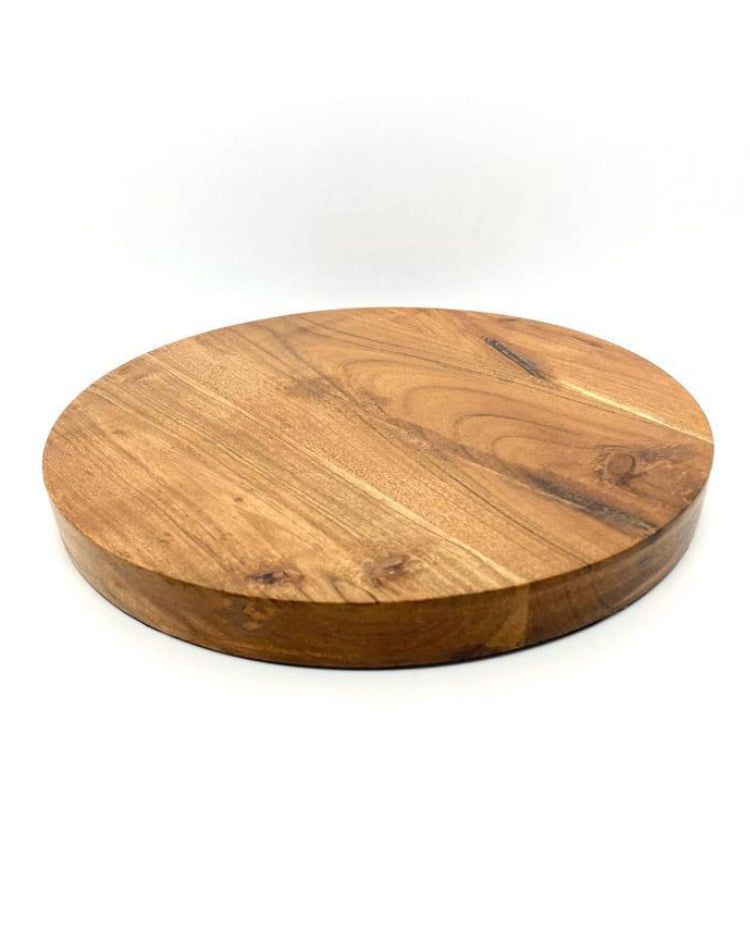 Prop Options round wooden acacia board supporting tiered cake