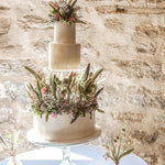 Prop Options clear fillable cake tier - floating cake illusion. Stunning tiered wedding cake using dried floral decorations.