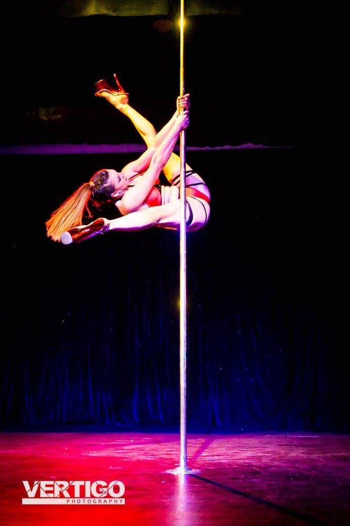 Pole dancer performing on stage