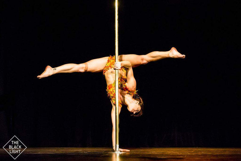 Pole dance performance photo handstand