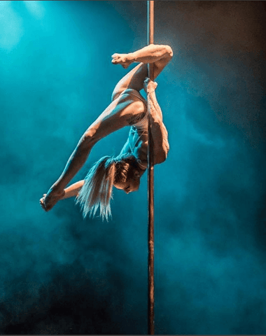 Pole dancer posing on pole
