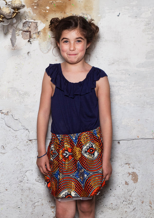 Cora & Lea - Niña- falda Twist and Shout. African Wax-Print, Estampado coronas doradas.