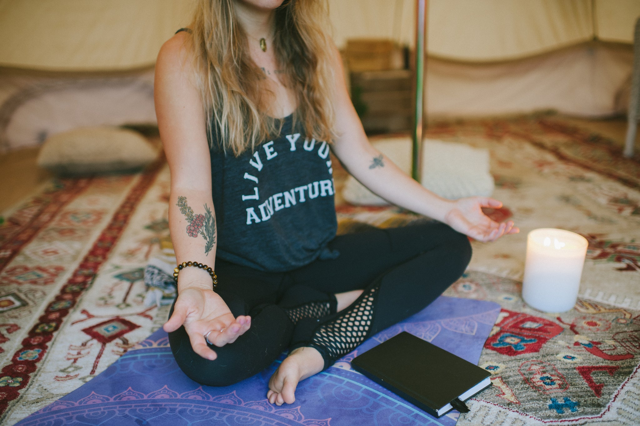Woman meditating with journal