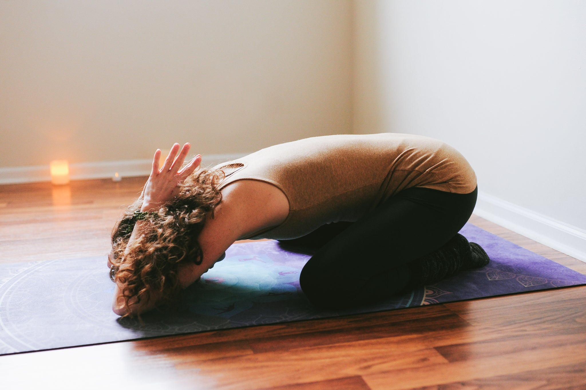 Yin yoga child's pose with prayer hands
