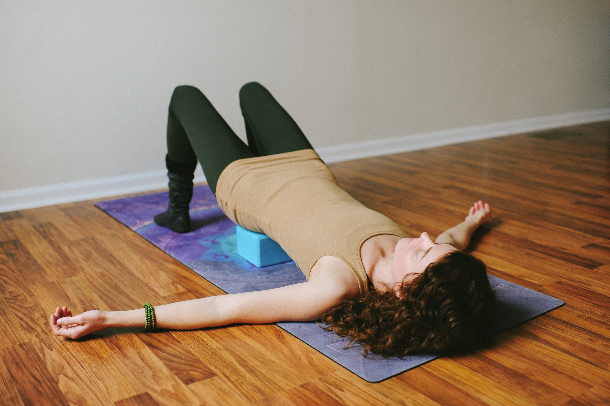 Yin Yoga supported bridge pose