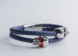 TOLVIC DOUBLE STEEL SKULLS W/ SAPPHIRE & LEATHER STRAP