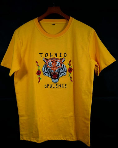 "DESCRIPTION  Tolvic Tiger Head Embroidered T-Shirt – White, Yellow Gold and Black  Cut from cotton jersey, this crewneck T-shirt presents the roaring tiger as an embroidered appliqué flanked by the embroidered phrase ""Tolvic Opulence.""  Introducing the tiger head, a symbol thought to represent wisdom and power. The roaring tiger head and rose flower are embroidered and applied to the chest.  White cotton jersey t-shirt with Tiger head Rose Tolvic Opulence embroidered.  Crew neck  Straight fit  100% cotton"