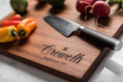 Personalized engraved premium wood cutting board in Sapele by Well Written Gifts