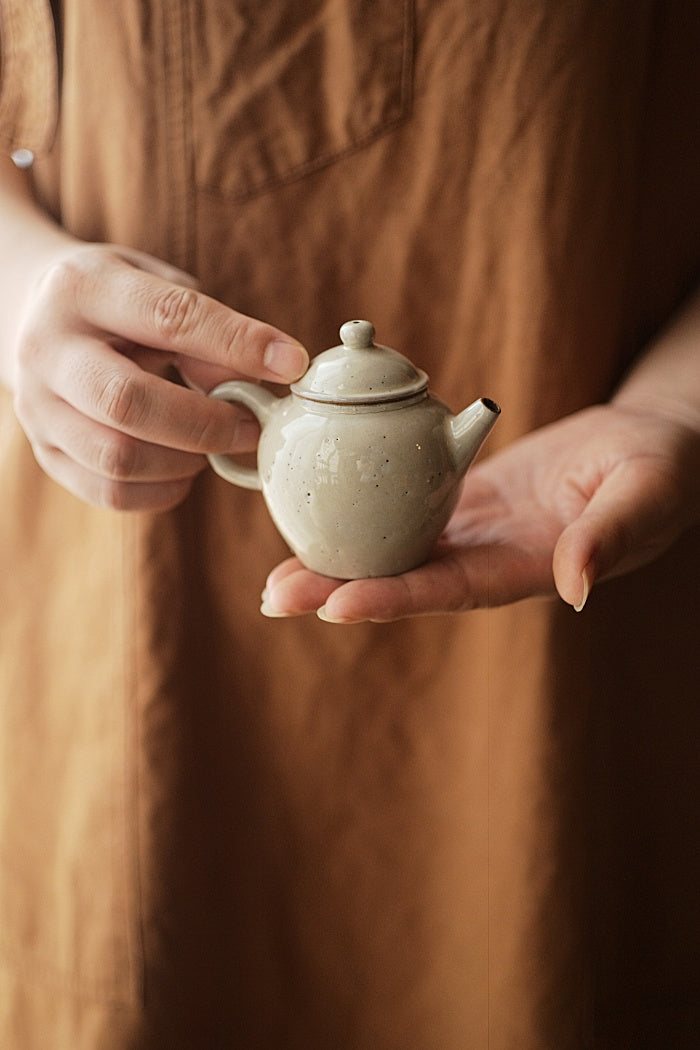 Tall brushed powder-glazed teapot
