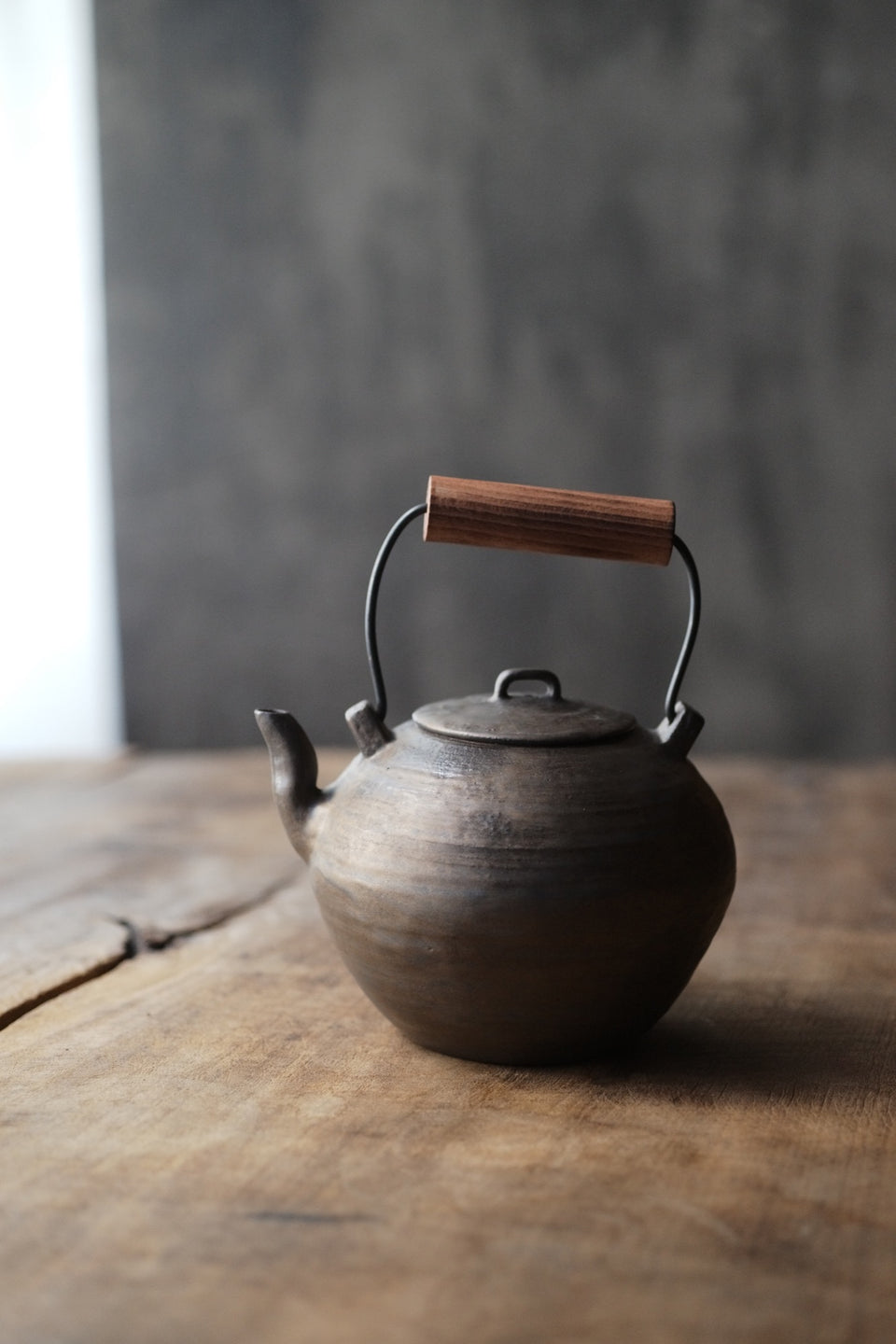 Wood-Handled Ceramic Kettle With Metal Glaze