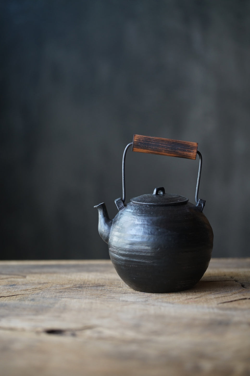 Wood-Handled Ceramic Kettle With Black Glaze