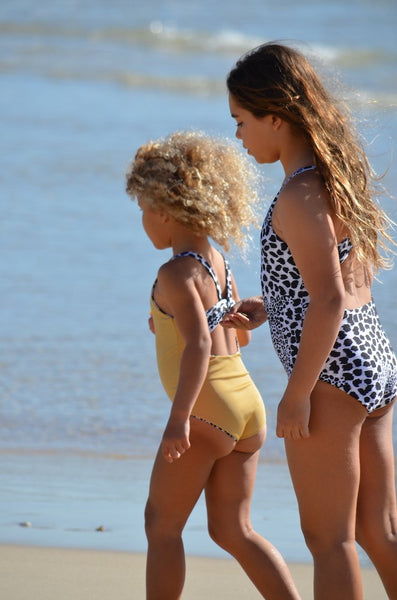 reversible swimwear, reversible togs, children's reversible swimsuit, children's swimwear, kids swimsuit, kids swimwear, one piece swimsuit, mustard swimsuit, ribbed swimsuit, ribbed swimwear, leopard swimsuit, leopard swimwear, children's swimwear, swimwear