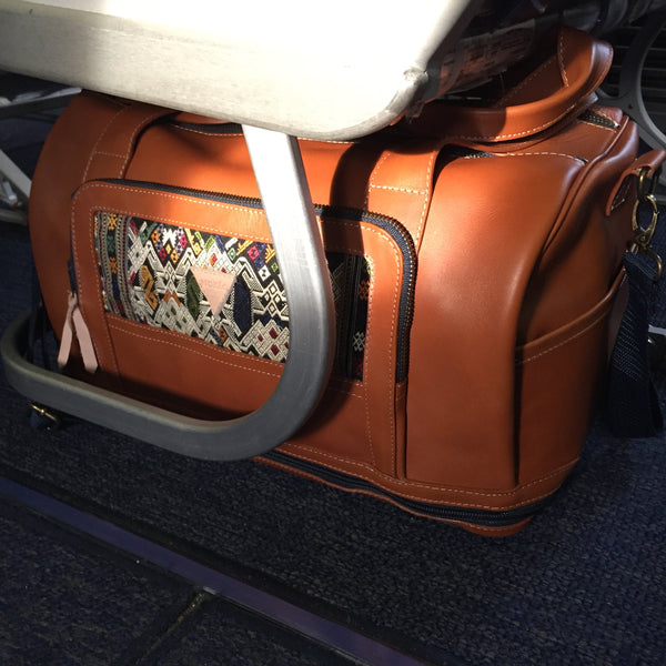 nokeo journey bag under the seat of a southwest airlines flight