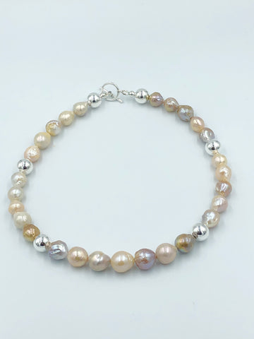 Freshwater baroque pearls in pastel colours with sterling silver beads