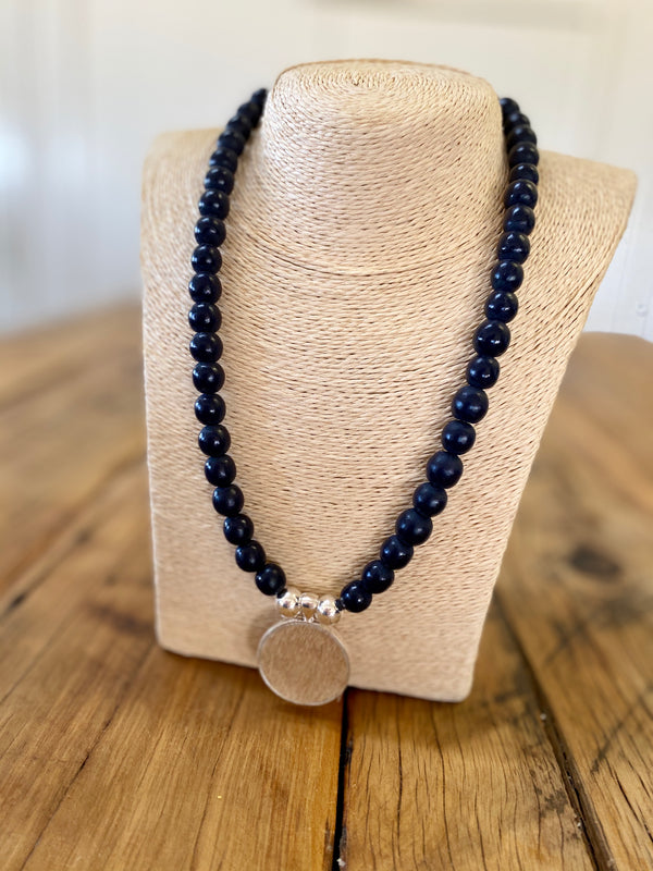 navy resin beads with sterling silver and caramel hide pendant