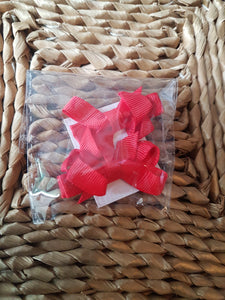 Small red bow hair clips