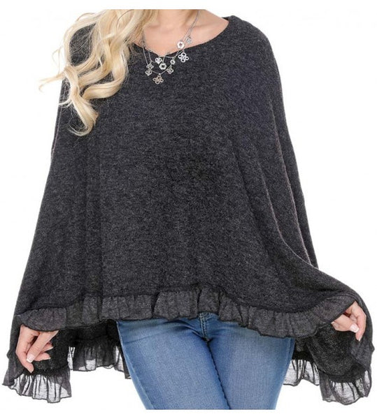 COZY PONCHO WITH RUFFLES