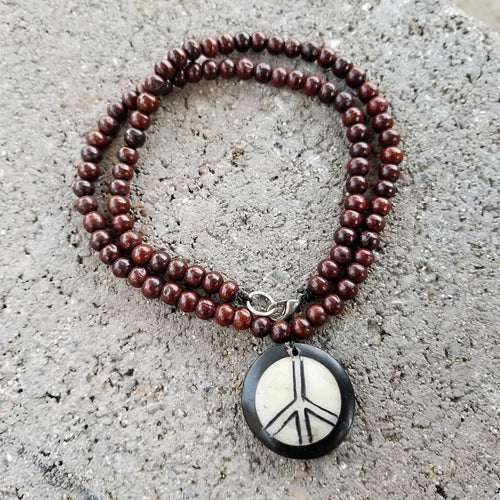 PEACE NECKLACE WITH ROSE WOOD BEADS