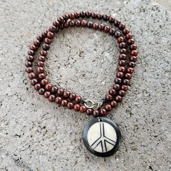 PEACE CARVED NECKLACE ROSE WOOD BEADS